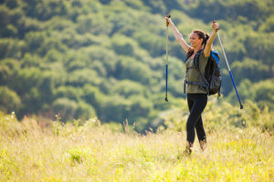 A woman hikes outside during wilderness therapy