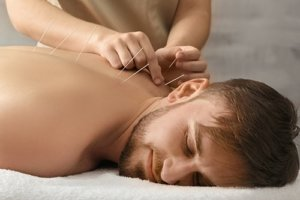man experiencing how acupuncture and addiction treatment connect